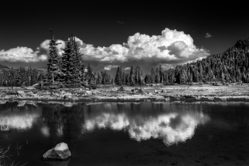 Clouds reflect in an alpine lake in the Mt. Jefferson wilderness.