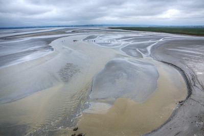 At low tide, guided walks across the mud flats at Mont-Saint-Michel on the Normandy coast, France.