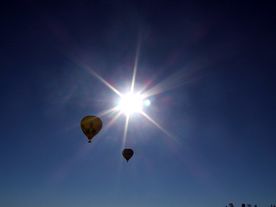 Hot Air Balloons rising into the sun