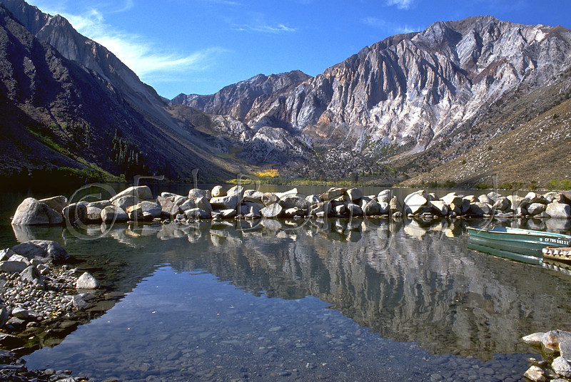 Convict Lake, 7,582 feet, two miles from Highway 395 in the Mammoth Lakes area of Mono County, CA.  Bordered by Mount Morrison, 12,240 feet and Laural Mountain at 11,824 feet Convict Lake is a popular vacation getaway for trout fishing, hiking, camping and horseback riding adventures.