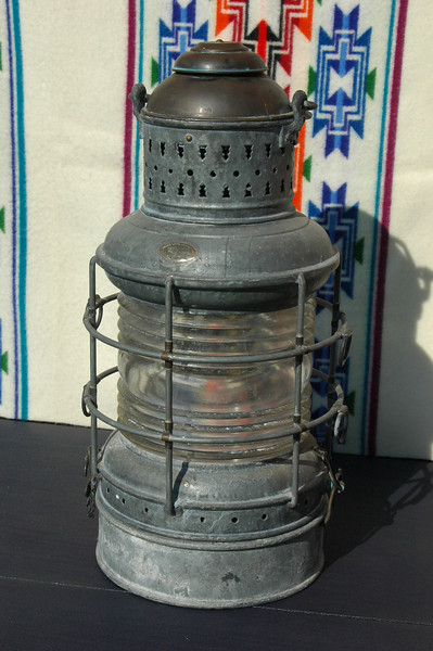 #A0001...this is a Perko fish trap-light as noted by the removable fuel tank as the base, mint condition with the exception of a small rubber-bushed hole for an electrical wire...$295.00<br /> <br /> 22 inches tall, not including the handle and 10 inches in diameter...<br /> <br /> Place your pointer on the picture above and then select from the transparent Menu to view these pictures in additional larger sizes..
