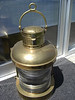 Light #A0002....Perko brass.<br /> <br /> 19 inches tall not including the handle...180 degree stern light with font<br /> <br /> Mint condition and was never used..<br /> <br /> Font is the fuel tank, burner and glass globe...$795.00