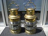 PERKO Brass, very rare set...#A0003 (set)...I will only sell these as a set. <br /> <br /> They are Triplex lenses and brass...these are 19 inches tall (24 inches including the handle) and 9 1/2 inches in diameter.<br /> <br /> Mint condition...unused with fonts, burners & globes.....$2500.00 for the set...