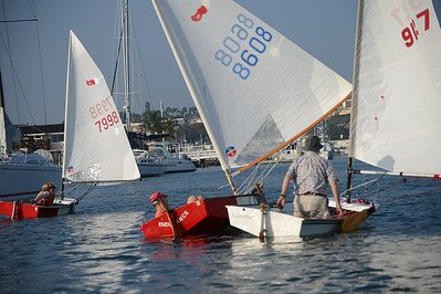 Photo of naples sabot sailboats sailing in a regatta