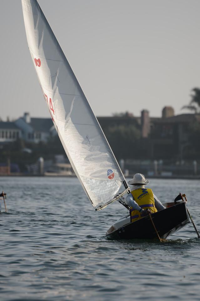 Photo of naples sabot sailboats sailing in a regatta