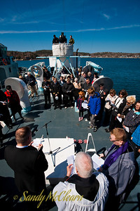 The memorial service takes place on the upper deck just aft of the main funnel.
