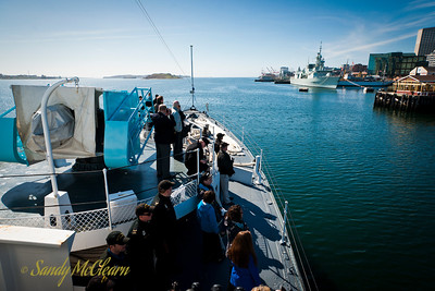 SACKVILLE cruises down the Halifax waterfront and approaches HMCS HALIFAX at her weekend berth in front of the Maritime Museum of the Atlantic.