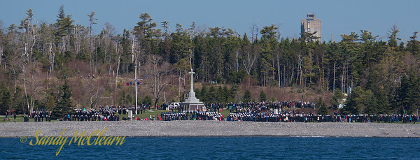 People are gathered by the Halifax Memorial in Point Pleasant Park for the Battle of the Atlantic service. The Memorial bears the names of military (Army & Navy) as well as merchant seamen who lost their lives in service of their country during the First and Second World Wars, and who have no known grave.