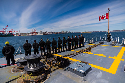 Foc'st'le party facing the Halifax shore during our return transit to Dockyard.