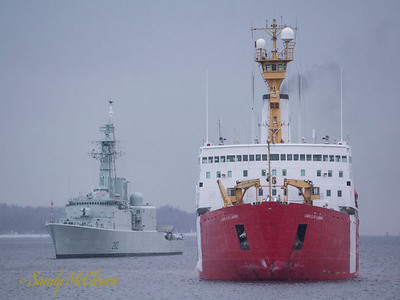 HMCS ATHABASKAN (DDH 282) and Louis S. St. Laurent.
