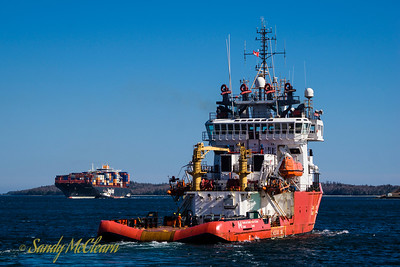 Hapag-Lloyd's Ningbo Express in the background of this shot of CCGS Sir Wilfred  Grenfell.