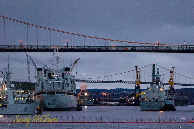 Early morning at HMC Dockyard, with HMCS GOOSE BAY (MM 707) and HMCS PRESERVER (AOR 510) alongside and with ST. JOHN'S (FFH 340) in the background at Halifax Shipyard, and FREDERICTON (FFH 337) undergoing a cold move to the right.