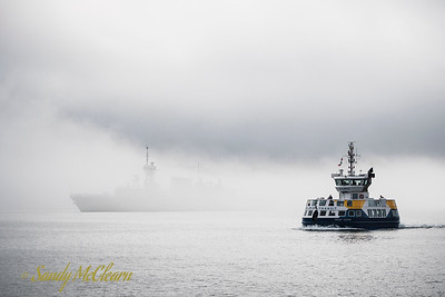 Vincent Coleman with HMCS ST. JOHN'S hiding in the background fog.