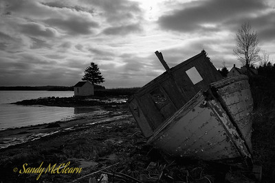 A wrecked fishing boat lies on the beach near Boutilier's Point, Nova Scotia.