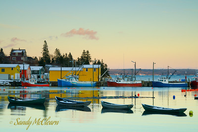 A line of small fishing tenders with fishing boats alongside in the background, in Northwest Cove, on Nova Scotia's Aspotogan Peninsula.