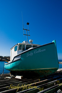 The Cape Island style fishing boat Lady Colleen is hauled out on the Aspotogan Peninsula, Nova Scotia.