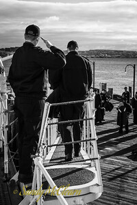Saluting before disembarking SACKVILLE to attend a safety conference.