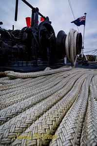 Ropes laid out on the deck to feed the winch.