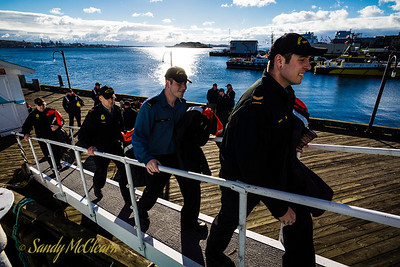 Sailors boarding HMCS SACKVILLE to handle lines and ready her for transfer back to HMC Dockyard.