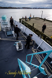 Sailors sorting ropes on the quarterdeck.