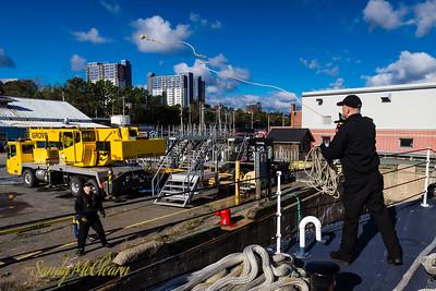 Heaving a line on arrival alongside in HMC Dockyard.