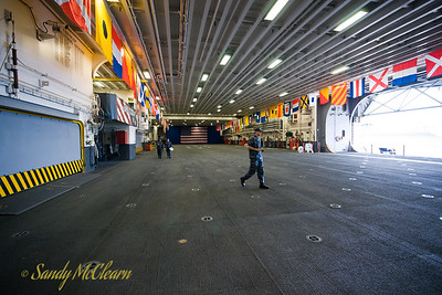 The upper hangar in USS WASP is used for aircraft storage and maintenance.
