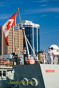 """All hands on deck, face aft."" The Canadian Naval Ensign, otherwise known as the Maple Leaf (Canada's national flag), is hauled up the ensign staff at the stern of HMCS ATHABASKAN."