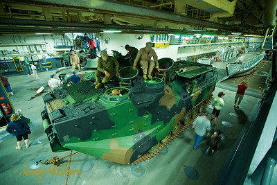 A tracked amphibious landing vehicle in the lower hangar of USS WASP.