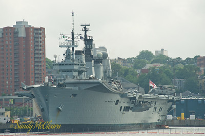 HMS ARK ROYAL, an INVINCIBLE class aircraft carrier of the Royal Navy. ARK is the Royal Navy's flagship. Various aircraft can be seen on deck including Harrier jets and Sea King and Merlin helicopters.