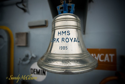 ARK ROYAL's bell is displayed on the flight deck.