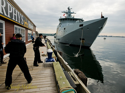 A work crew from HMCS ATHABASKAN handles the lines as HDMS EJNAR MIKKELSEN comes alongside Cable Wharf.