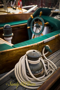 Rope coiled around a winch on a schooner.