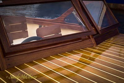 Operable windshield on a small wooden runabout.