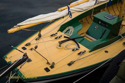 A small traditional sailboat.