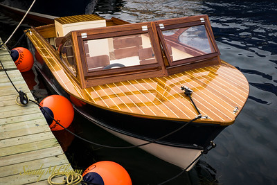 Small wooden runabout.