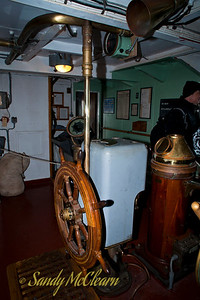 The helmsman of the S.S. Jeremiah O'Brien would follow commands from the bridge via the voice pipe int the upper right of the image.