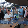 Larry and sailboat club members celebrating his birthday at Vermilion Public Docks, with Ed, Port Authority Manager and wife.