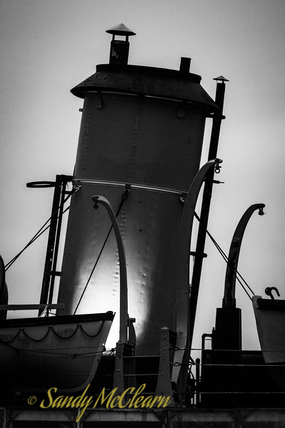 Funnel of the former CSS Acadia illuminated prior to sunrise.
