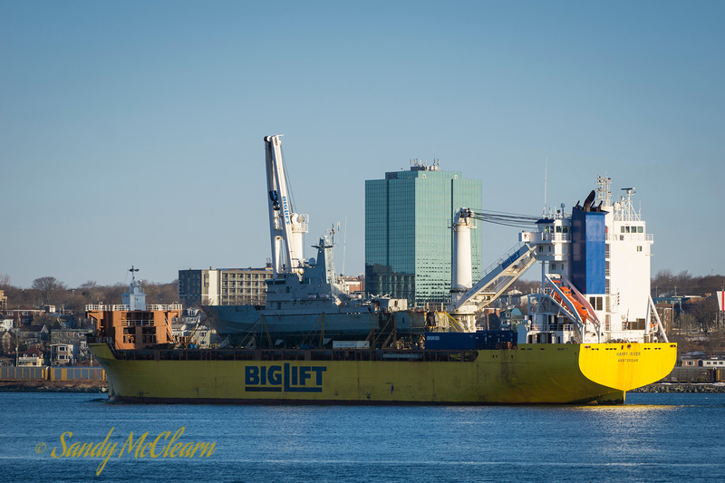 """Big Lift's """"Happy River"""" with HMBS BAHAMAS on board, presumably headed to Europe for refit."""