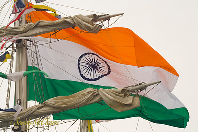 The Indian flag flies from the mast of INS Tarangini, the Indian Navy's sail training vessel.