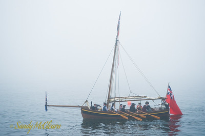 With no wind available, this longboat is forced to use manual methods of propulsion.