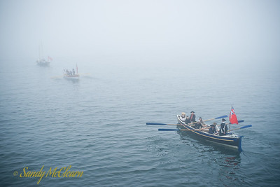 Three longboats in the fog.