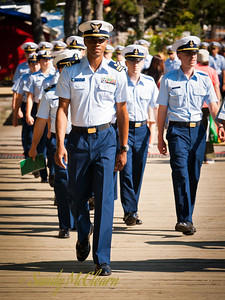 US Coast Guard personnel from USCGB Eagle head towards the starting point of the crew parade.