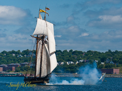 Pride of Baltimore II fires her cannon.