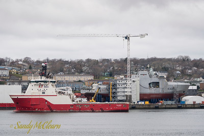 Boa Bison and the future HMCS HARRY DEWOLFE at the Halifax Shipyard.