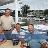 Local entrepreneur Greg Ondus, in white, hosting friends.