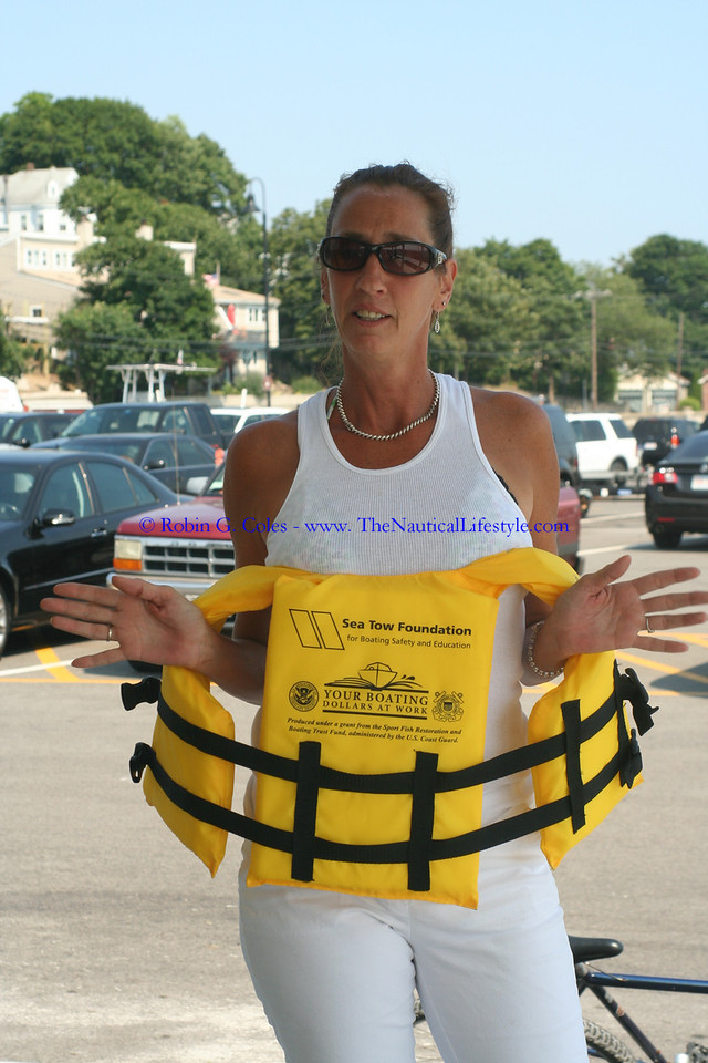 Lisa showing off the complimentary lifejackets provided by Sea Tow at the Winthrop Town Landing.