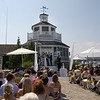 Cape Cod wedding ceremony outside the lighthouse at Nauticus Marina