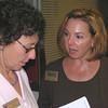 Nice Guy Lynn Cihak speaks with ASYMCA Hospital Director Cherri Barnswell.