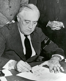 President Roosevelt signs Declaration of War on Japan - December 8, 1941.